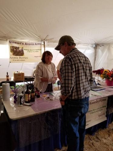 Jolene Stewart of Stewart's Aronia Acres samples haskaps & berries- Value Added Ag Day- S.D. State Fair 2019. Courtesy VAADC.