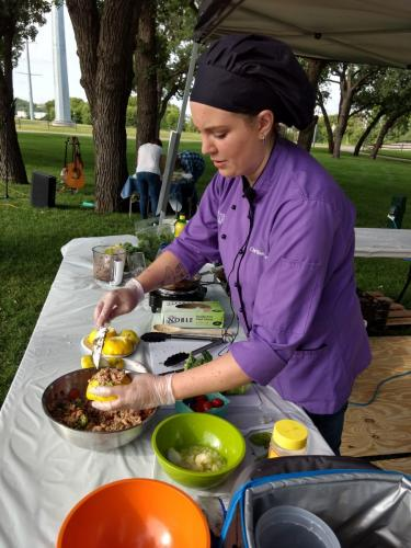Sioux Falls Local Foods Fair 2019- Chef Ellen-Personal Chef- preparing chard basil pesto and sausage stuffed patty pan squash