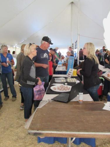 Stensland Family Farm & Chelsea Stensland discussing their ice cream and cheese- Value Added Ag Day- S.D. State Fair 2019.