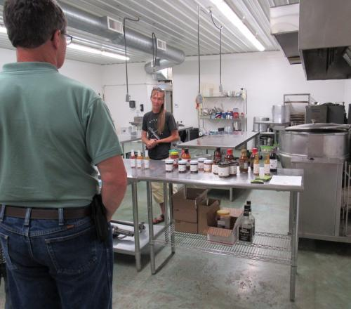 Grandma D's Kitchen, onsite commercial kitchen with owner Teal Scholl, talks about hot pack process & product marketing.