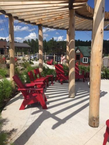 Pergola & chairs at Custer Healing & Wellness Garden, Custer Regional Hospital- Aug. 9, 2019.
